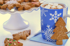 Hot chocolate and ginger cookies. Hot chocolate with marshmallows and tree shape gingerbread cookies Stock Photography