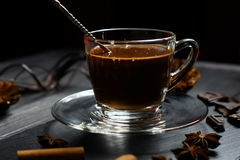 Hot chocolate in a glass cup. On a dark background Stock Photo