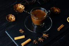 Hot chocolate in a glass cup. On a dark background Royalty Free Stock Photography
