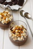 Hot chocolate in glass with pop corn on table.  Stock Photo