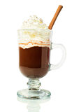Hot chocolate in a glass with whipped cream and cinnamon Royalty Free Stock Photo