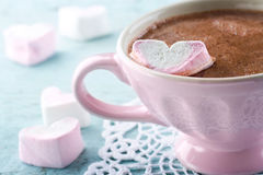 Hot chocolate and a heart shaped marsmallow Stock Photos