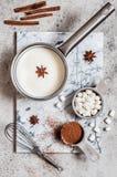 Hot Chocolate Ingredients. Milk, Spices, Cocoa Powder, Marshmallows stock photos
