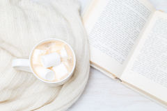 Hot chocolate, knitted sweater and book. View from above. Hot chocolate, knitted sweater and book. flat lay Royalty Free Stock Images