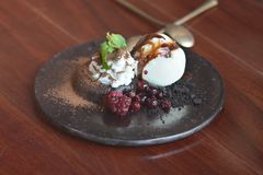 Hot chocolate lava cake with raspberries and vanilla ice-cream stock images