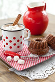 Hot chocolate with little cakes Stock Images