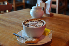 Hot chocolate with the look of a milfoil, Puerto Varas, Chile.  Royalty Free Stock Photos