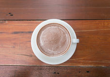 Hot chocolate malt. A cup of hot chocolate malt on wood table Stock Photography