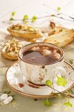 Hot chocolate with marshmallow and bruschetta or crostini. Hot chocolate or cocoa with marshmallow and bruschetta or crostini for breakfast royalty free stock image