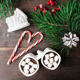Hot chocolate with marshmallow with toy house and candies royalty free stock photo
