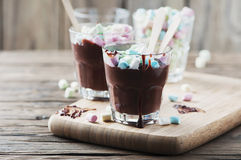 Hot chocolate with marshmallow on the wooden table Royalty Free Stock Images