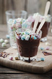 Hot chocolate with marshmallow on the wooden table Royalty Free Stock Photos