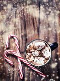 Hot Chocolate with marshmallows and candy stick, traditional bev Royalty Free Stock Image