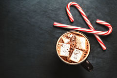 Hot Chocolate with marshmallows and candy stick, traditional bev Stock Images