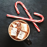 Hot Chocolate with marshmallows and candy stick, traditional bev Stock Photo