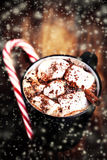 Hot Chocolate with marshmallows and candy stick, traditional bev Stock Image