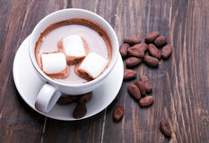 Hot chocolate with marshmallows and cocoa beans Royalty Free Stock Photo
