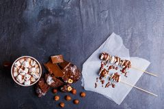 Hot chocolate with marshmallows in a cup next to other sweets. View from top stock images