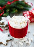 Hot chocolate with marshmallows. And gingerbread cookie on a old wooden table stock photography