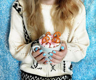Hot chocolate with marshmallows in girl`s hands Royalty Free Stock Photos