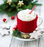 Hot chocolate with marshmallows. And gingerbread cookie on a old wooden table stock photos