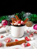 Hot chocolate with marshmallows. New Year composition made of hot chocolate, Christmas tree decorations and candy canes stock images