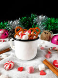 Hot chocolate with marshmallows. New Year composition made of hot chocolate, Christmas tree decorations and candy canes royalty free stock photos