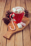 Hot chocolate and marshmallows in red polka dots cup royalty free stock photos