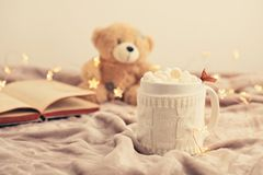 Hot chocolate with marshmallows on soft plaid background with Ch Royalty Free Stock Photos