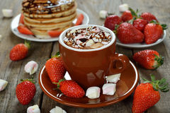 Hot chocolate with marshmallows and strawberries Stock Photos