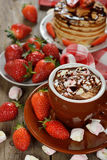Hot chocolate with marshmallows and strawberries Stock Image