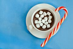 Hot chocolate with marshmallows and sugar cane. Top view. Royalty Free Stock Image