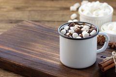 Hot chocolate with marshmallows in a white metal vintage mug stock photos