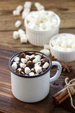 Hot chocolate with marshmallows in a white metal vintage mug royalty free stock photo