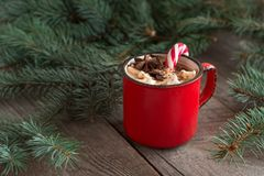 Hot chocolate with marshmallows on the wooden background fir-tree. Christmas tree with candy cane and mug with coffee. Hot cocoa w Royalty Free Stock Photos