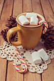 Hot chocolate and marshmallows on wooden table Royalty Free Stock Photography