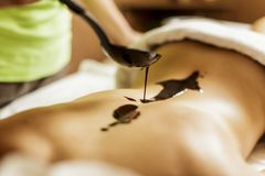 Hot chocolate massage Stock Images