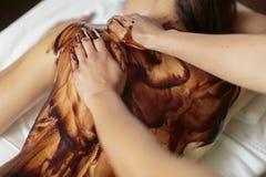 Hot chocolate massage Stock Photography