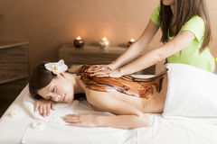 Hot chocolate massage. View at the women having a hot chocolate massage Royalty Free Stock Photography