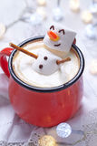 Hot chocolate with melted snowman Royalty Free Stock Photography