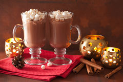 Hot chocolate with mini marshmallows cinnamon winter drink candl Royalty Free Stock Images