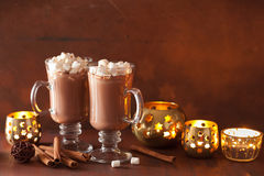 Hot chocolate with mini marshmallows cinnamon winter drink candl Royalty Free Stock Photography