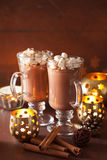 Hot chocolate with mini marshmallows cinnamon winter drink candl Stock Images