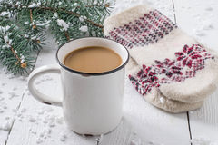 Hot chocolate in a mug and warm knitted mittens Royalty Free Stock Image