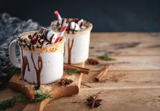 Hot chocolate in mugs on wooden background, copy space royalty free stock photo