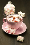 Hot chocolate in pink cup with marshmallows Royalty Free Stock Images