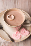 Hot chocolate and pink hearts stock photo