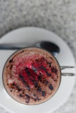 Hot chocolate with raspberry powder. Stock Photos
