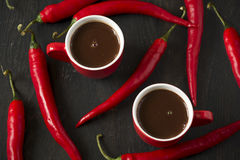 Hot chocolate with red chili peppers Stock Images