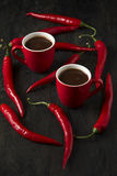 Hot chocolate with red chili peppers Stock Photos